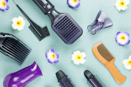 Photo for Hairdressing tools with flowers on blue wooden background. Top view, flat lay - Royalty Free Image
