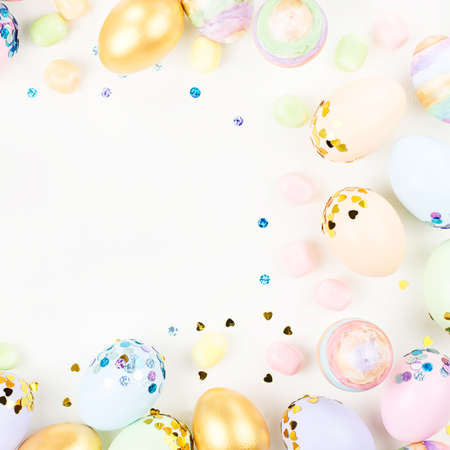 Photo for Festive Happy Easter background with decorated eggs, flowers, candy and ribbons in pastel colors on white. Copy space - Royalty Free Image