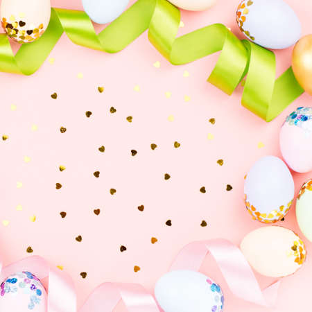 Photo for Festive Easter background with decorated eggs, flowers, candy and ribbons in pastel colors on pink background - Royalty Free Image