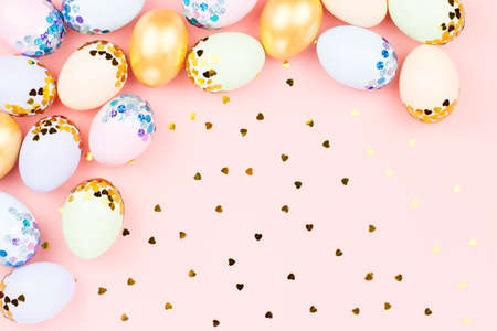 Photo for Festive Happy Easter background with decorated eggs, flowers, candy and ribbons in pastel colors on pink. Copy space - Royalty Free Image