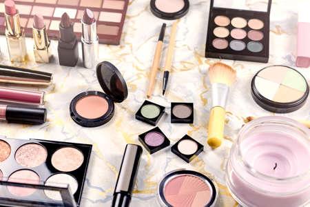 Foto de Various makeup products on table, flat design. Woman cosmetic essentials - Imagen libre de derechos