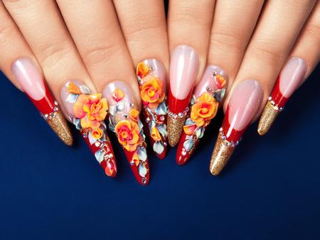 Photo for Art design female nails on blue background. - Royalty Free Image