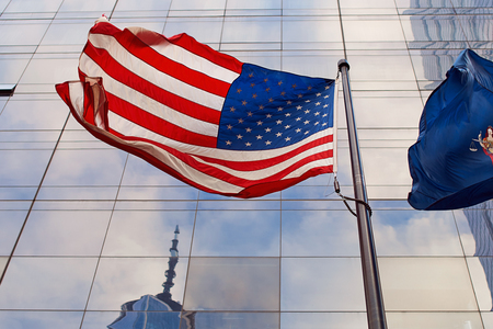 Photo pour Flag of the United States in front of the skyscrapers in New York City - image libre de droit