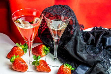 Photo for Valentines day background with champagne glasses stawberries and a sexy lace underwear thrown on it - Royalty Free Image