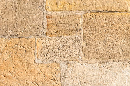 Photo for very old sandstone wall worked by a stonemason - Royalty Free Image