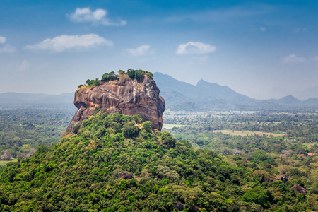 Photo for Spectacular view of the Sigiriya Lion rock surrounded by green rich vegetation. Picture taken from Pidurangala mountain in Dambula, Sri Lanka. - Royalty Free Image