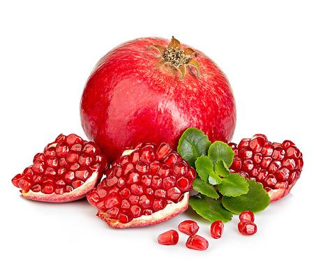 Photo pour Ripe pomegranates with leaves close-up on a white background. - image libre de droit
