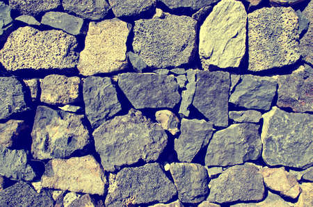 Close up of old stone wall texture. Architecture vintage brick background.