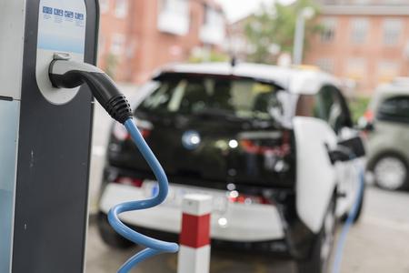 Photo pour An electric car at a charging station - image libre de droit