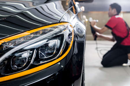 Photo pour Car polishing series : Polishing black car - image libre de droit