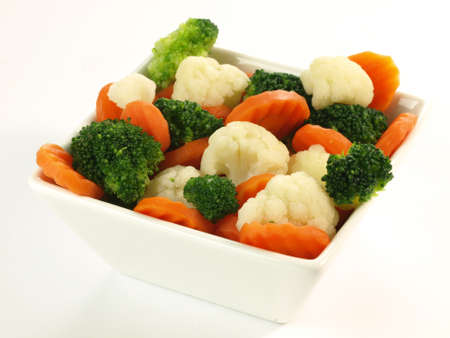 Bowl of boiled vegetables on isolated background