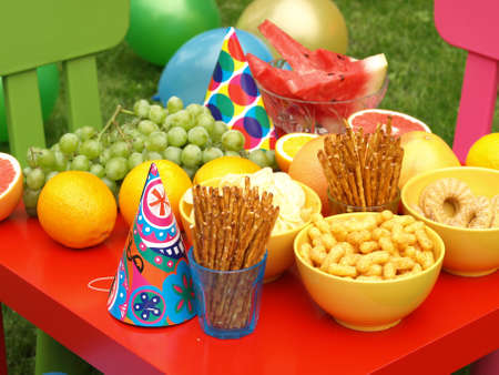 Photo for Colorful equipment for a childrens party in garden - Royalty Free Image