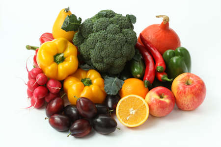 Pile of colorful fruits and veggies on isolated background
