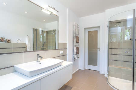 Photo pour Bright space - a white and beige bathroom with a sink and a shower - image libre de droit