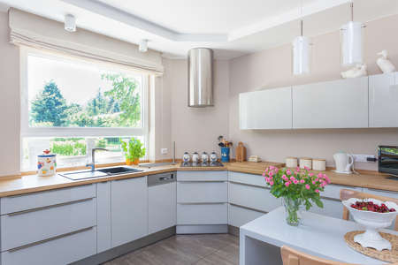Foto de Bright space - a bright and spacious kitchen with a view of a garden - Imagen libre de derechos