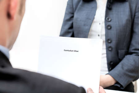 Photo for An interview and manager holding curriculum vitae - Royalty Free Image