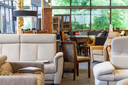 Foto de A warehouse with furniture such as sofas, chairs and lamps - Imagen libre de derechos