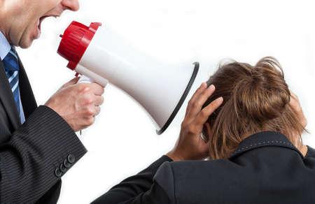 Foto de Businessman yelling at his worker, isolated background - Imagen libre de derechos