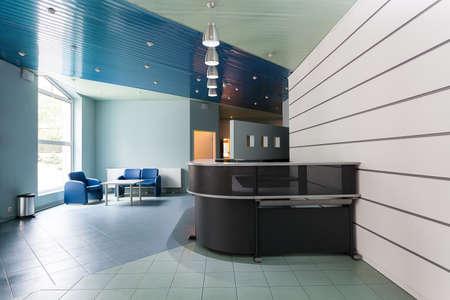 Foto de Blue and grey reception in a hallway of factory - Imagen libre de derechos