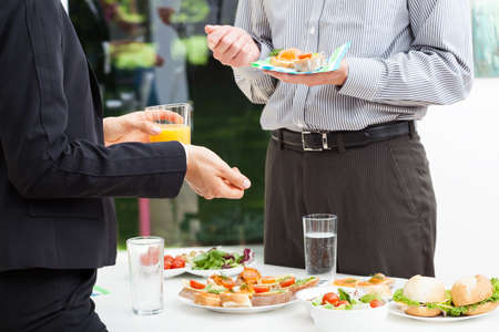 Photo for Business colleagues talks during lunch, outdoor - Royalty Free Image