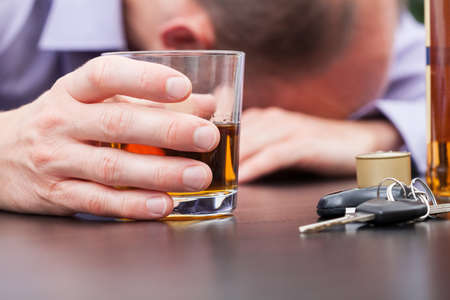 Photo for Alcoholic sleeping on the table with car keys - Royalty Free Image