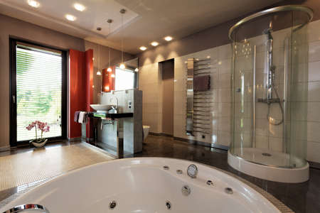 Photo for Luxury bathroom with bath and glass shower - Royalty Free Image