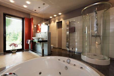 Photo pour Luxury bathroom with bath and glass shower - image libre de droit
