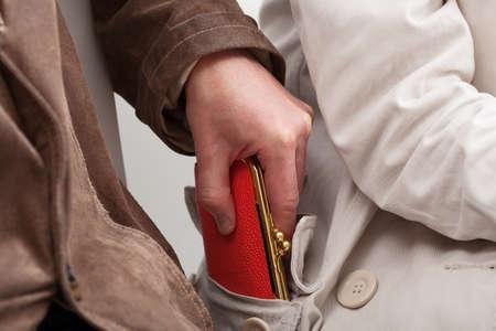 Foto de Pickpocket are stealing a woman - Imagen libre de derechos