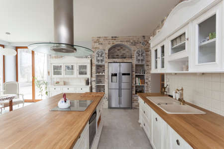 Photo pour Tuscany - countertop, commode and refrigerator in kitchen - image libre de droit