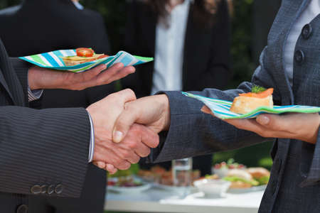 Photo for Business handshake during lunch on the open air - Royalty Free Image