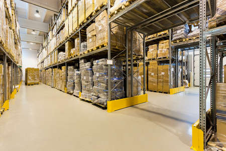 Photo for Interior of a huge spacious warehouse with carton boxes - Royalty Free Image