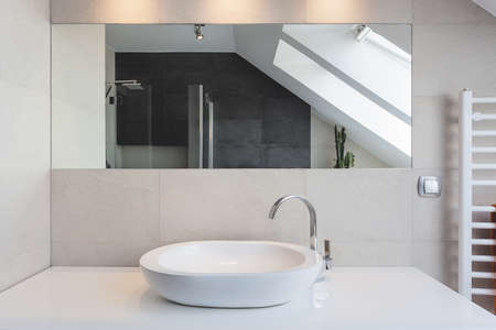 Photo for Urban apartment - white bath counter and vessel sink - Royalty Free Image