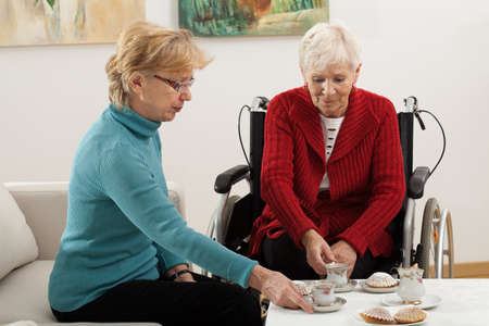 Photo for Two elder women drinking coffee and spending time together - Royalty Free Image