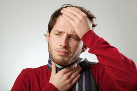 Foto de Man with headache and strong sore throat probably has cold - Imagen libre de derechos