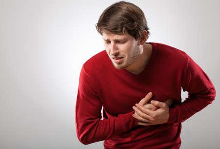 Foto de Young athletic man has a sudden heart attack - Imagen libre de derechos