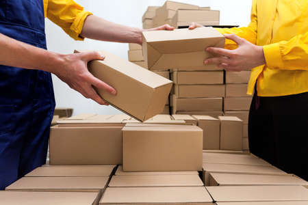 Photo for Workers in parcel delivery company preparing a deliver - Royalty Free Image