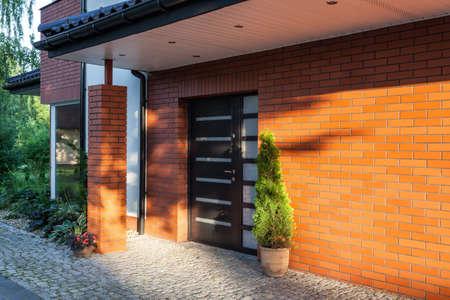 Photo pour Front door of a modern brick house - image libre de droit
