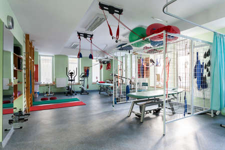 Photo for Spatial hall rehabilitation with differents exercises machines - Royalty Free Image