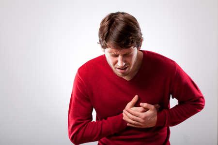 Foto de Young man with strong chest pain, horizontal - Imagen libre de derechos