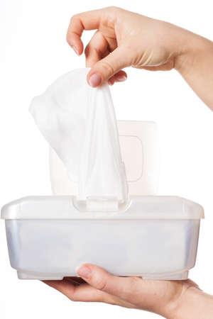 Photo pour Woman drawing white wet wipe from plastic box - image libre de droit