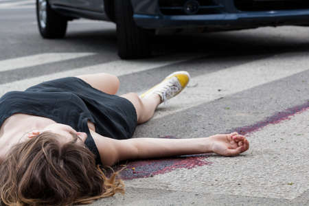 Photo for Horizontal view of woman hit by a car - Royalty Free Image