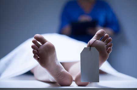 Photo for Horizontal view of identification of dead body - Royalty Free Image
