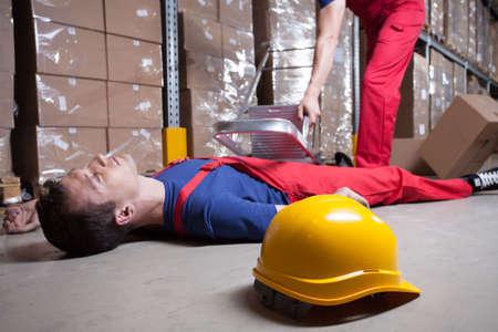 Foto de Accident during work at height in factory - Imagen libre de derechos