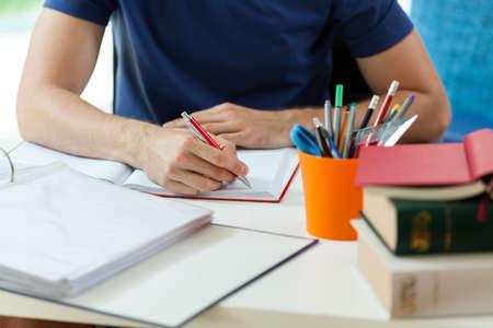 Foto de Horizontal view of student during doing homework - Imagen libre de derechos
