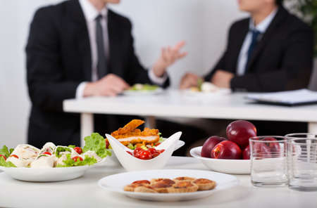 Photo for Close-up of a food and men during lunch break - Royalty Free Image