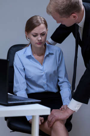 Photo for Problem of sexual harassment at work, vertical - Royalty Free Image