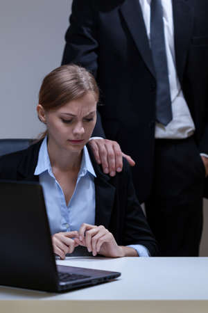 Photo for View of woman who doesn't like boss's touch - Royalty Free Image