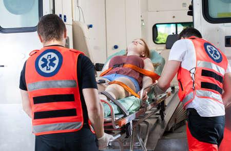 Foto de Woman after accident in ambulance, horizontal - Imagen libre de derechos