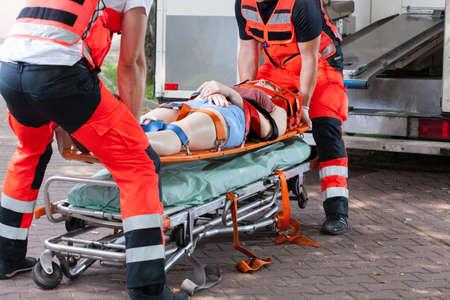 Foto de Woman after accident on the stretcher, horizontal - Imagen libre de derechos