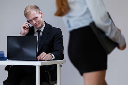 Photo for Male worker looking at sexy woman, horizontal - Royalty Free Image